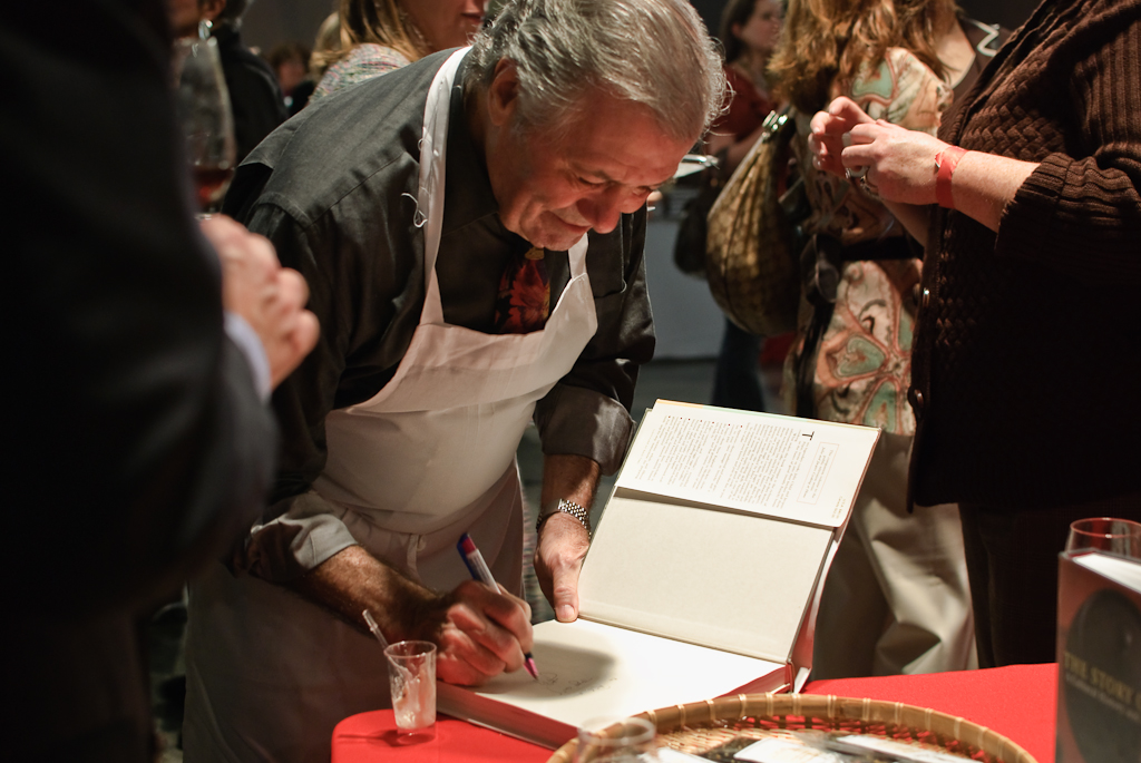 Host Jacques Pépin Signing a Cookbook